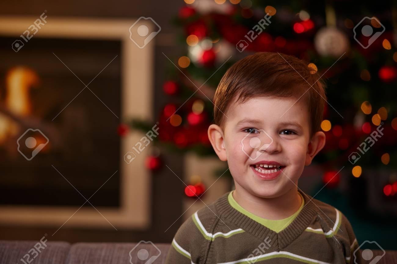 Closeup portrait of small boy at christmas, looking at camera, smiling. Stock Photo - 7791881