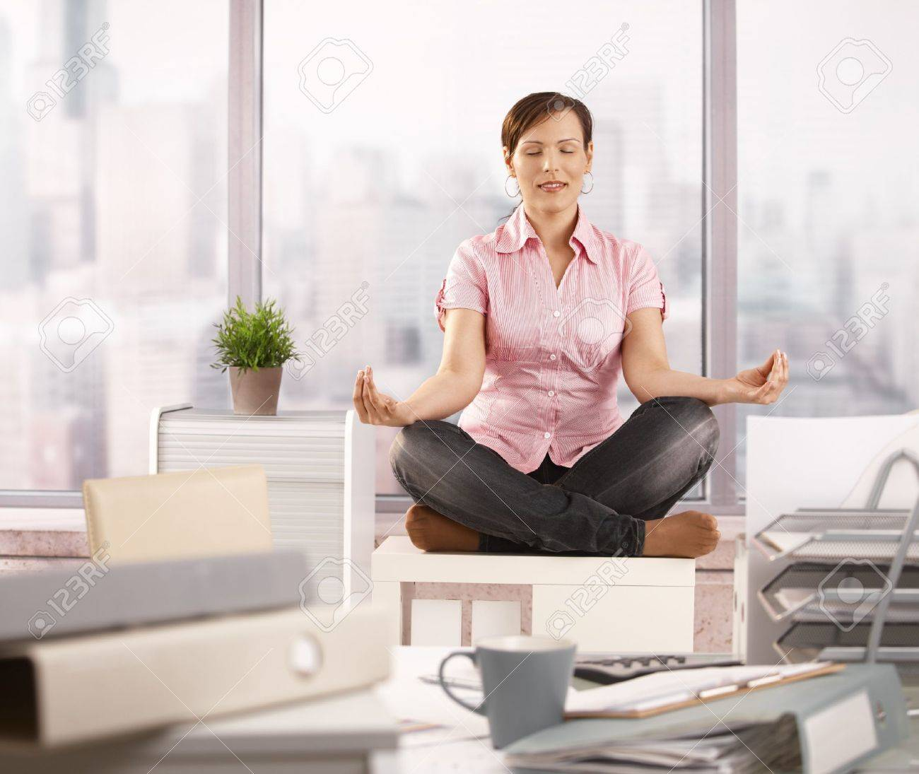 meditation office. Relaxed Office Worker Sitting On Cabinet, Doing Yoga Meditation With Closed Eyes, Smiling. N