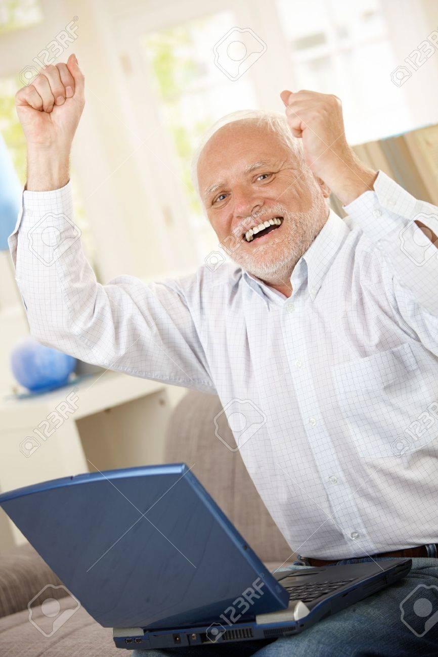 7899203-old-man-celebrating-at-home-laug