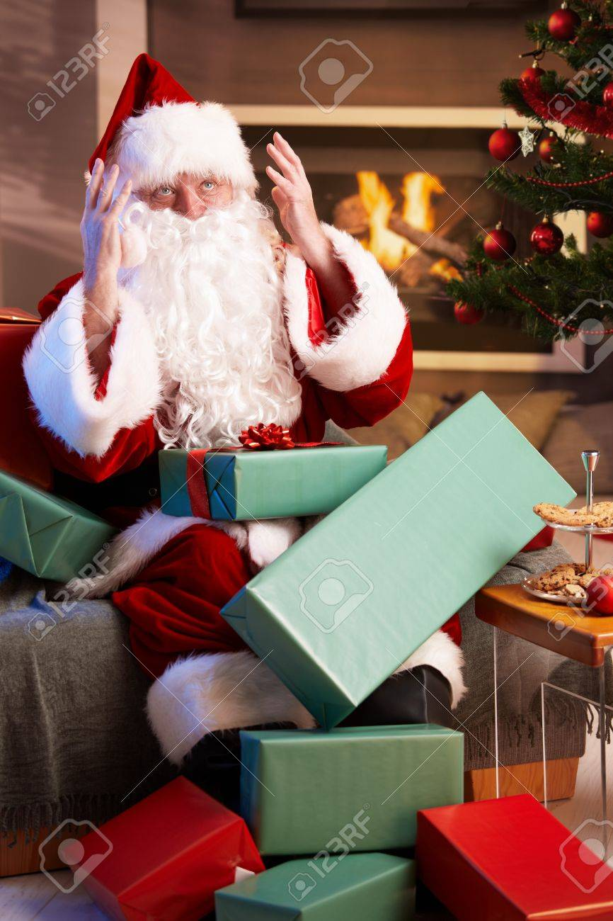 busy santa claus looking lost having too much work to do stock busy santa claus looking lost having too much work to do stock photo 7899680