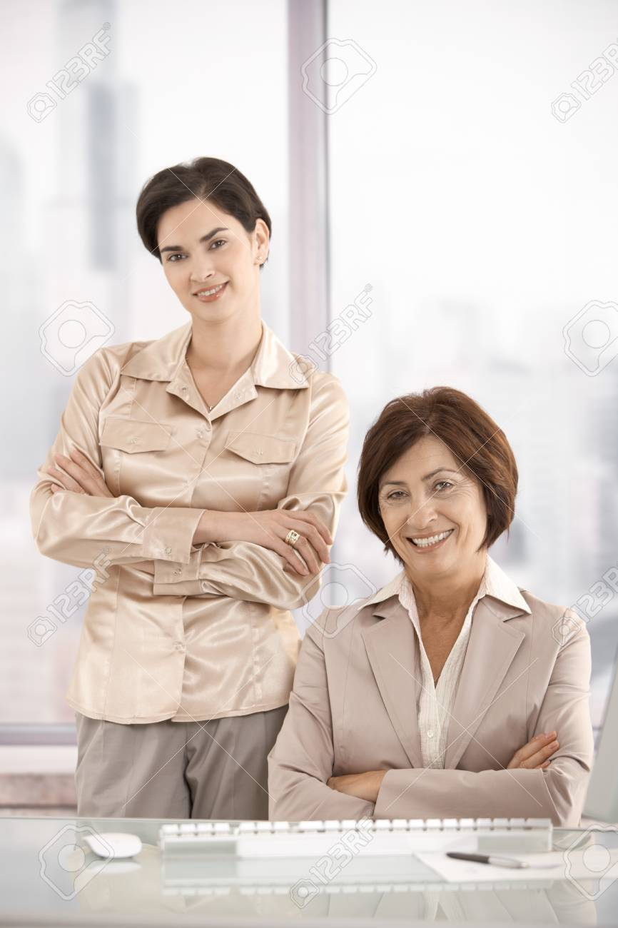 Portrait of businesswomen in office, smiling at camera. Stock Photo - 7962004