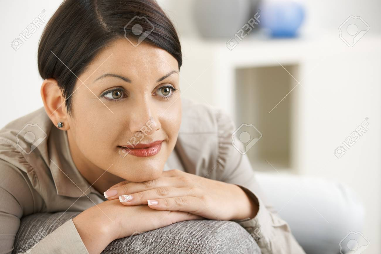 Portrait of attractive woman resting on sofa at home, smiling. . Stock Photo - 8138177