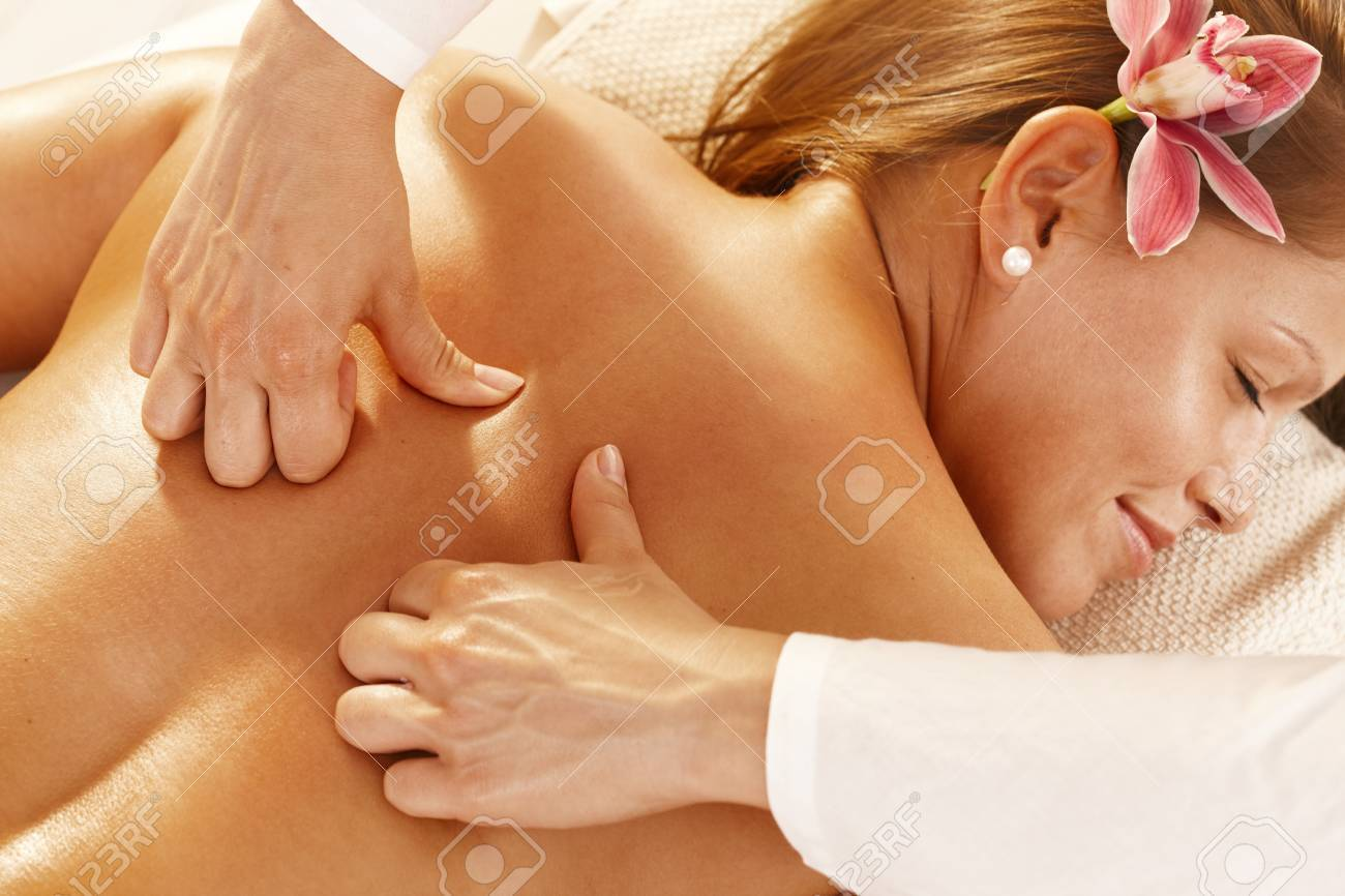 Closeup photo of masseur's hands doing deep tissue massage. Stock Photo - 8141768