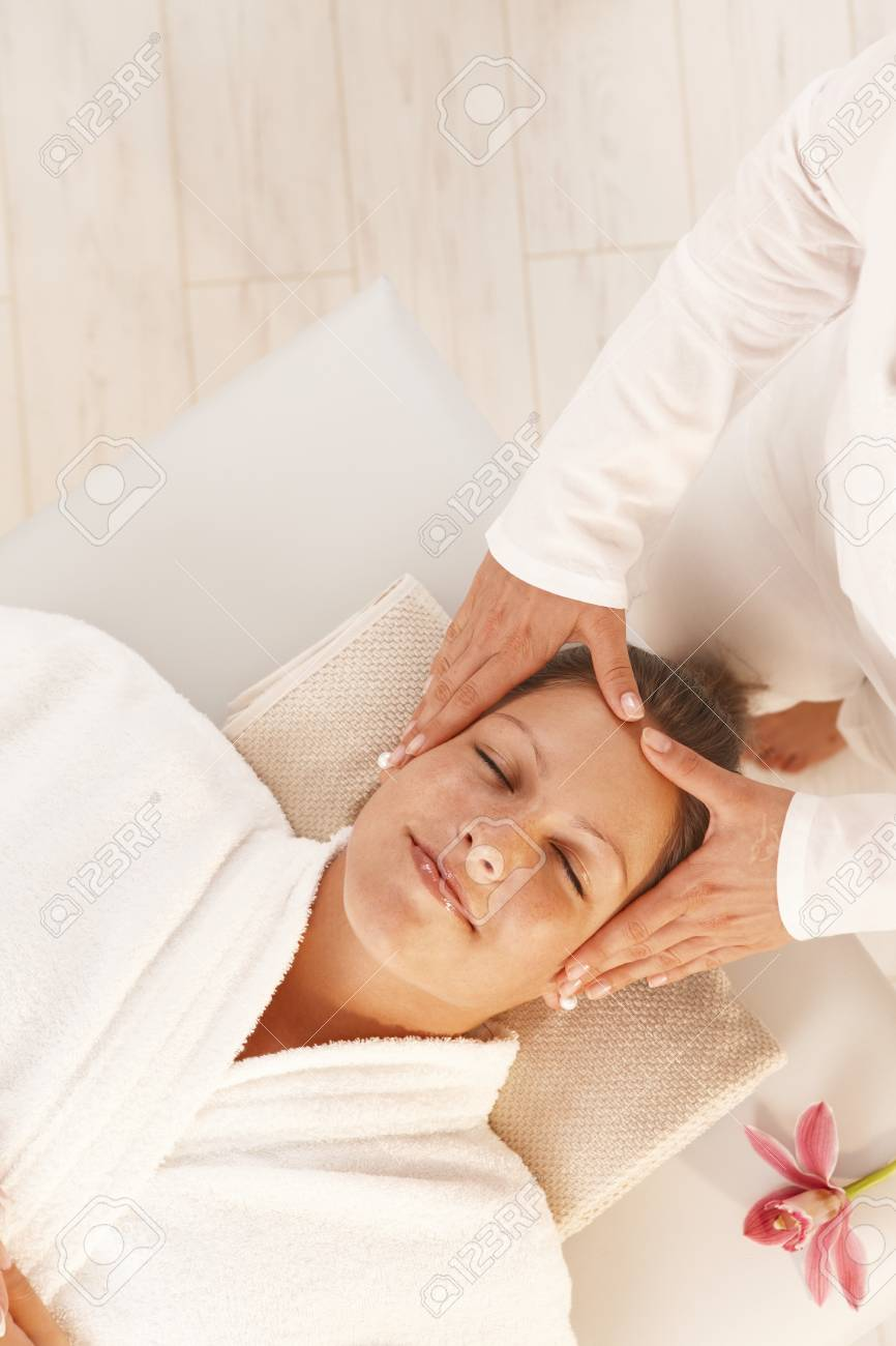 Woman getting relaxing head massage in dayspa. Stock Photo - 8141732