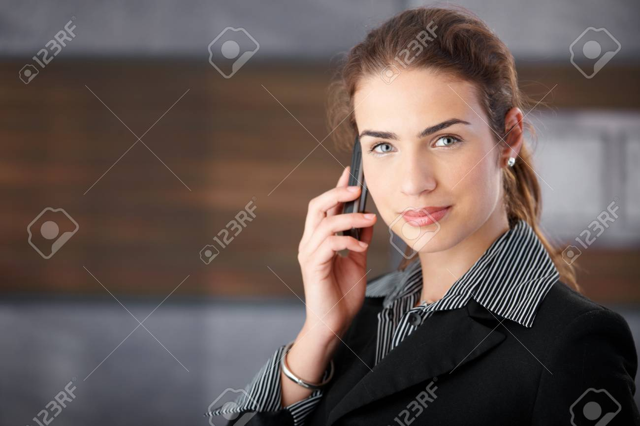 Attractive young businesswoman using cellphone. Stock Photo - 8552069