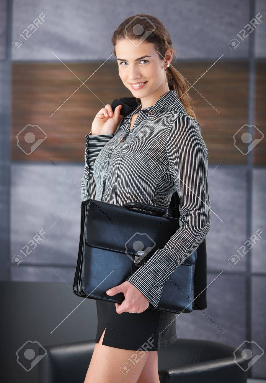 pretty businessw smiling happily holding briefcase wearing pretty businessw smiling happily holding briefcase wearing mini skirt going to job interview