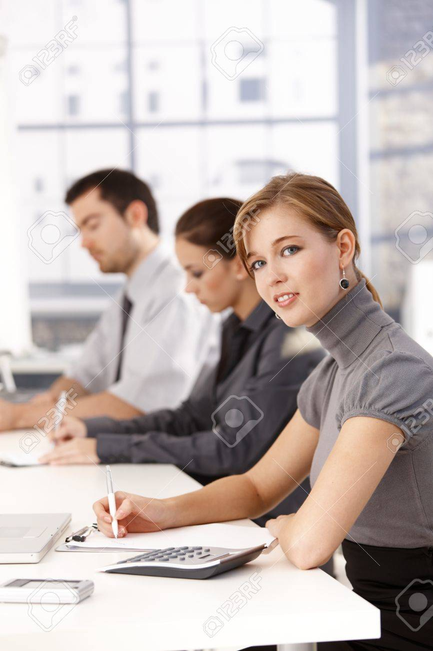 Young businessteam having a meeting, writing notes. Stock Photo - 8551997