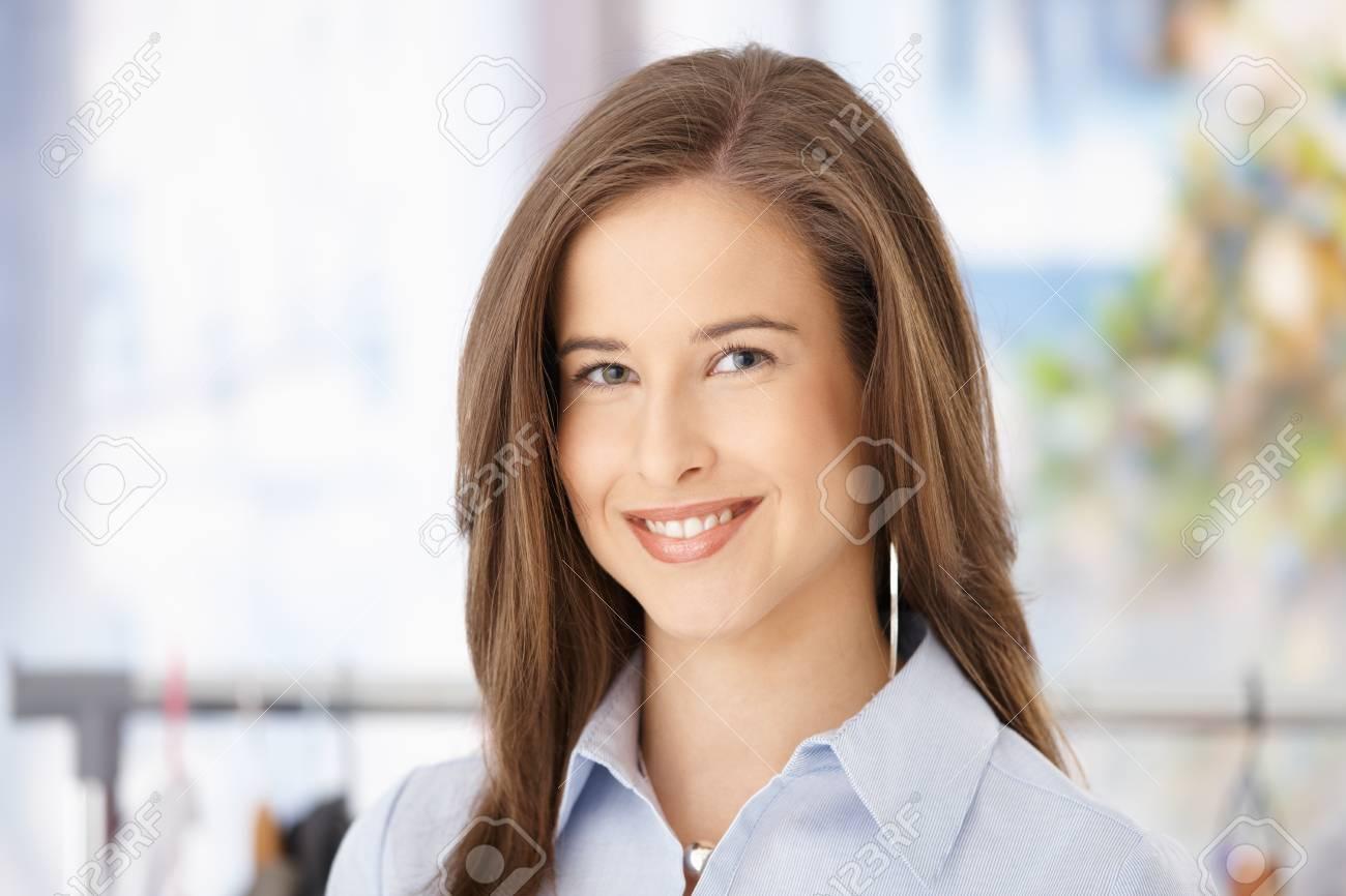 Closeup facial portrait of attractive woman smiling at camera. Stock Photo - 8604159