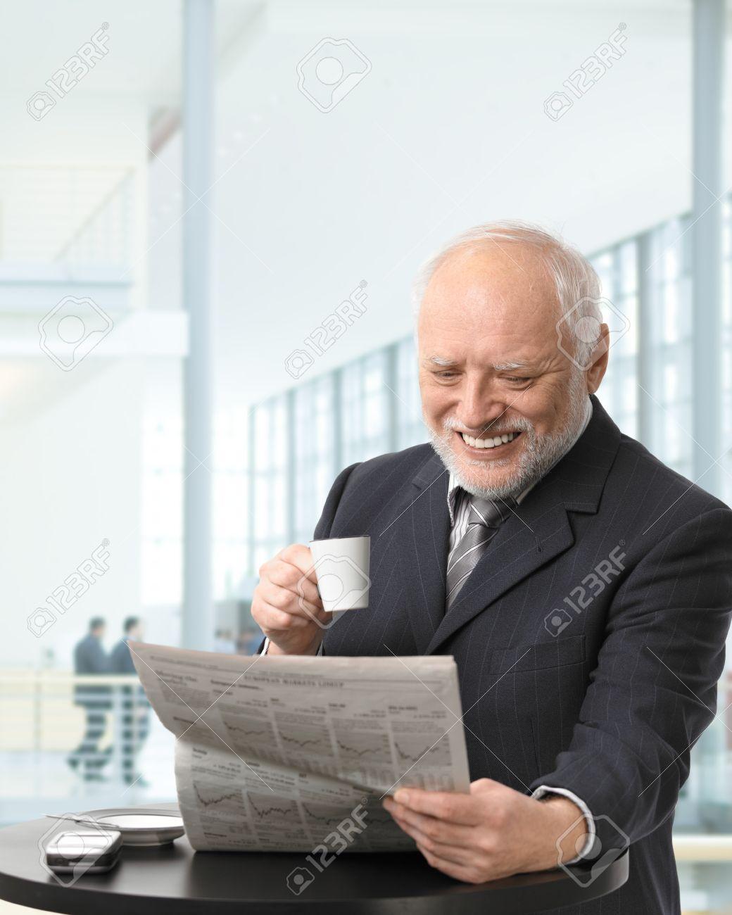 Image result for senior business man reading stock