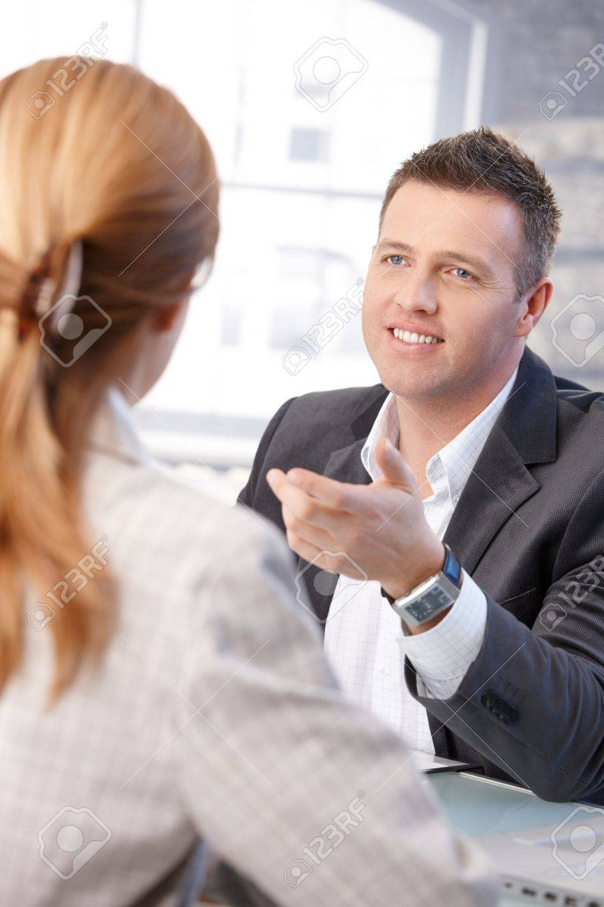 cheerful male manager interviewing female candidate in office cheerful male manager interviewing female candidate in office stock photo 8747099