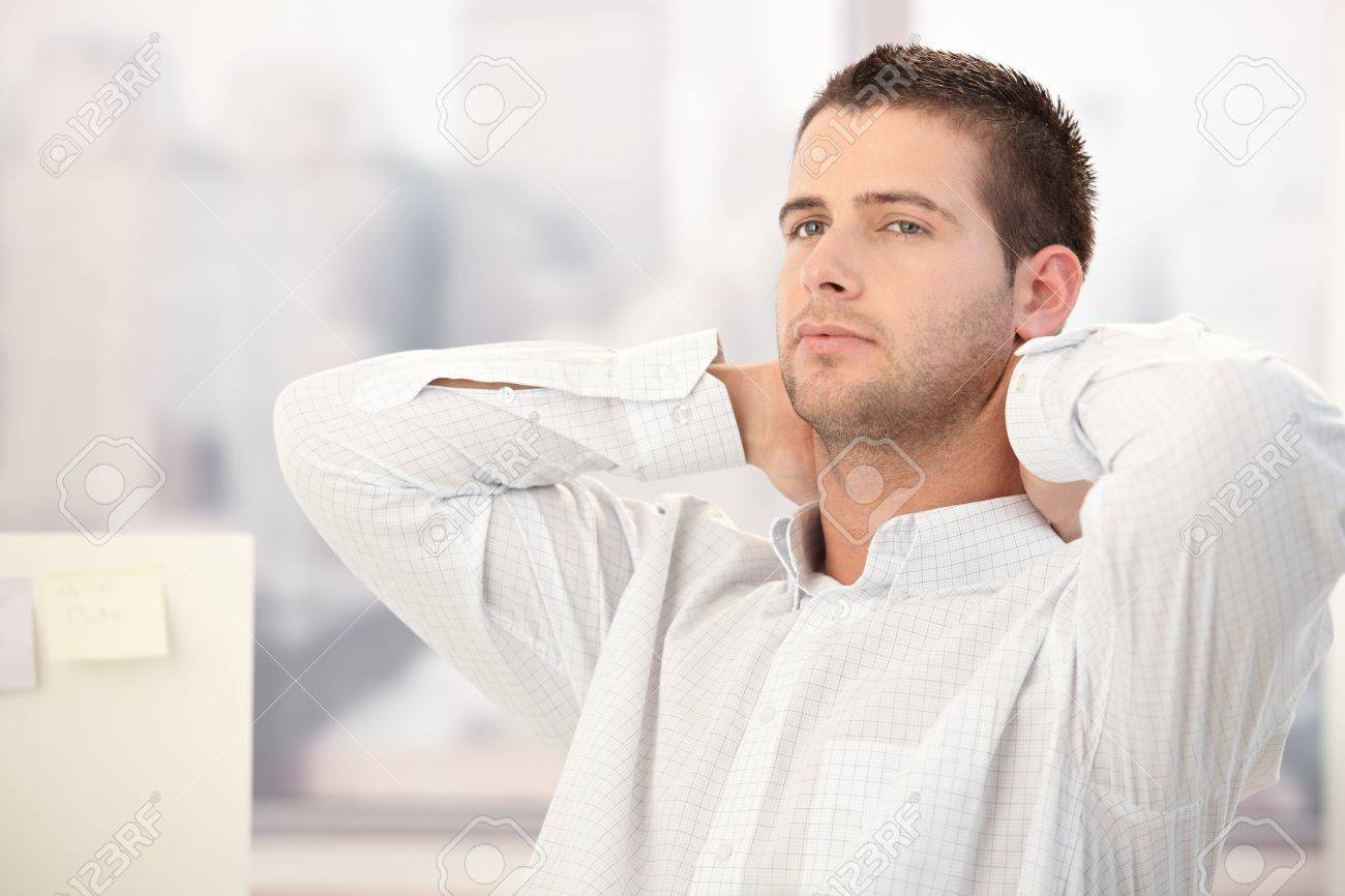 Young man thinking with hands on back of the neck. Stock Photo - 8747312