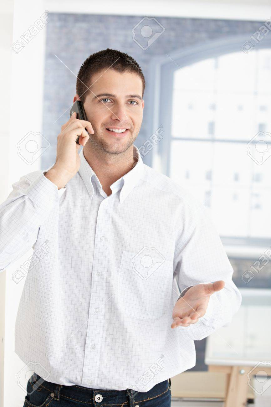 Happy young man talking on mobile phone. Stock Photo - 8747305