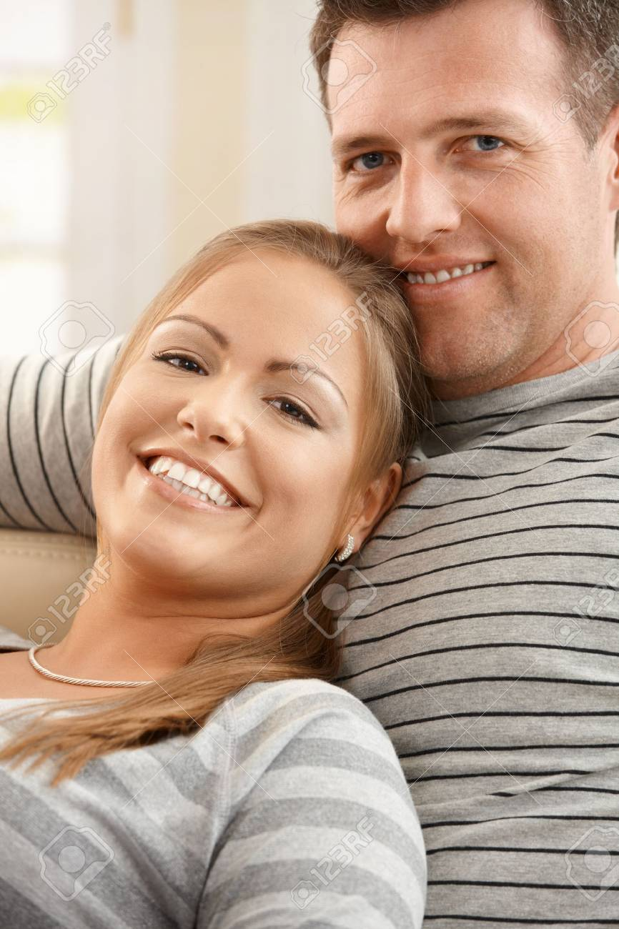 Portrait of happy couple relaxing together, smiling at camera. Stock Photo - 8747991