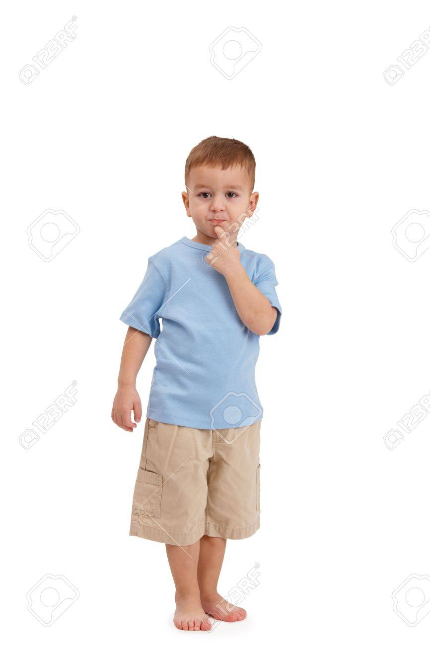 Little boy posing, pulling face, looking at camera in studio. Stock Photo - 8747671
