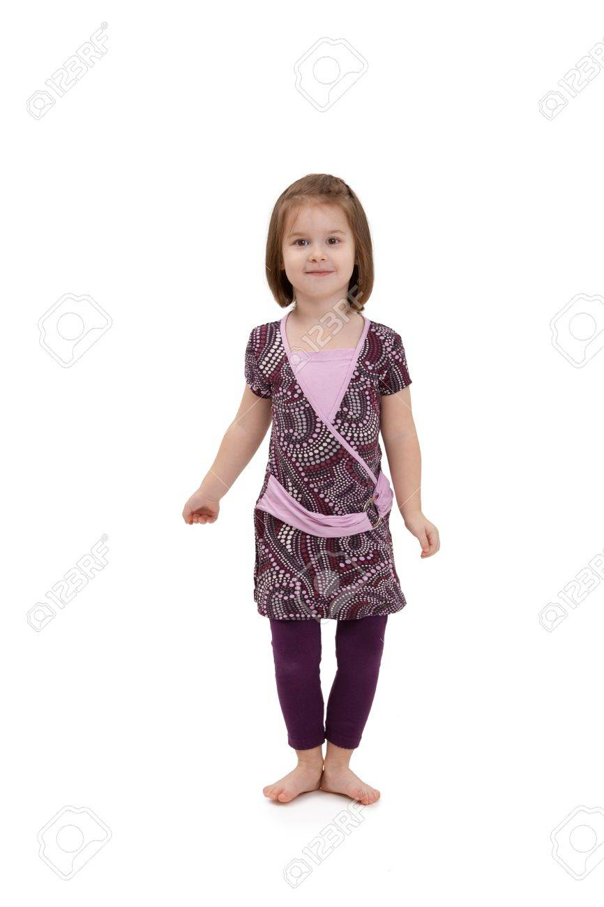 Happy little girl posing in pretty dress, smiling at camera. Stock Photo - 8747614