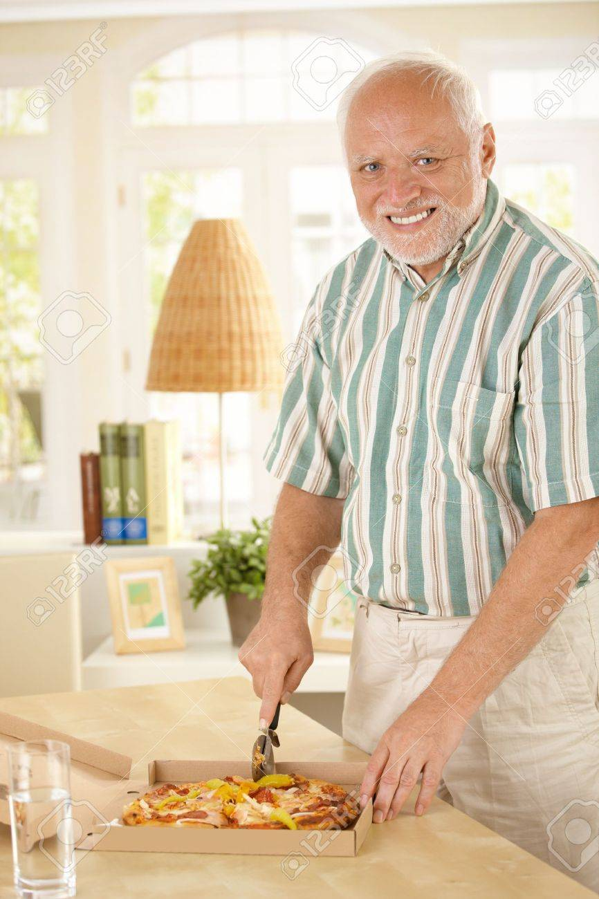 [Image: 8748777-Smiling-senior-man-cutting-up-pi...-Photo.jpg]