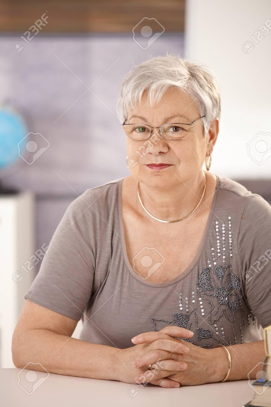 Portrait of senior teacher in classroom, looking at camera. Stock Photo - 8783614