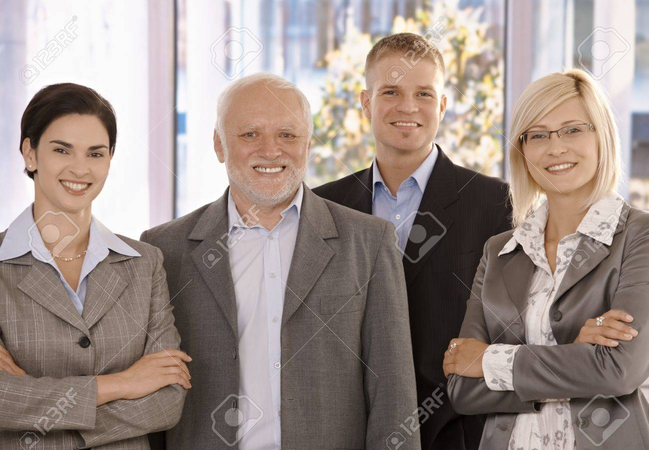 Portrait of smiling businessteam standing in office. Stock Photo - 8783754