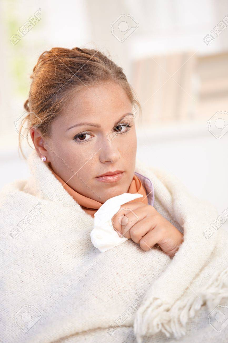 Young female having flu, feeling bad, wrapped up in blanket. Stock Photo - 8895495