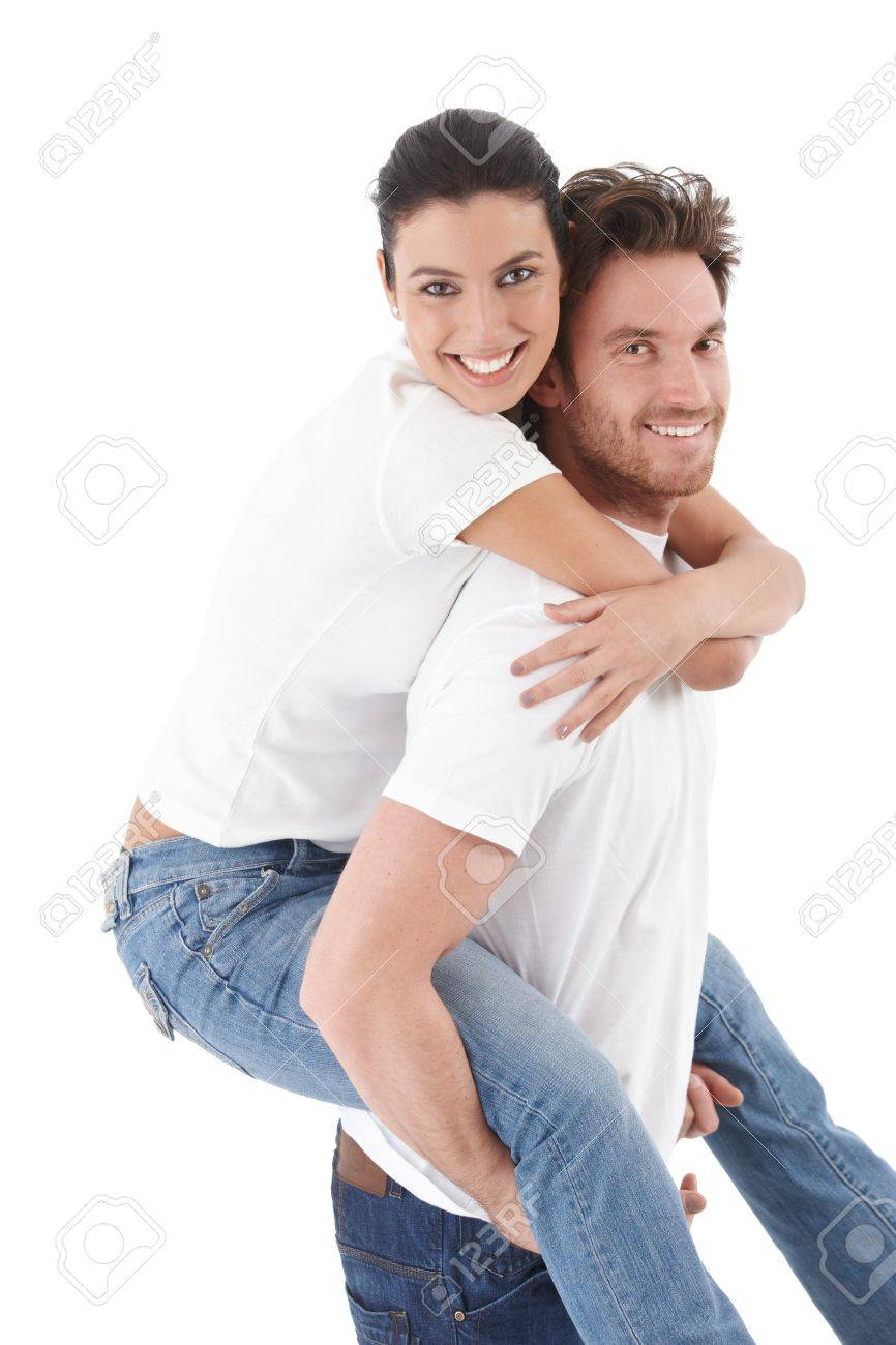 Happy loving couple smiling, hugging each other, man carrying woman pickaback. Stock Photo - 9201793