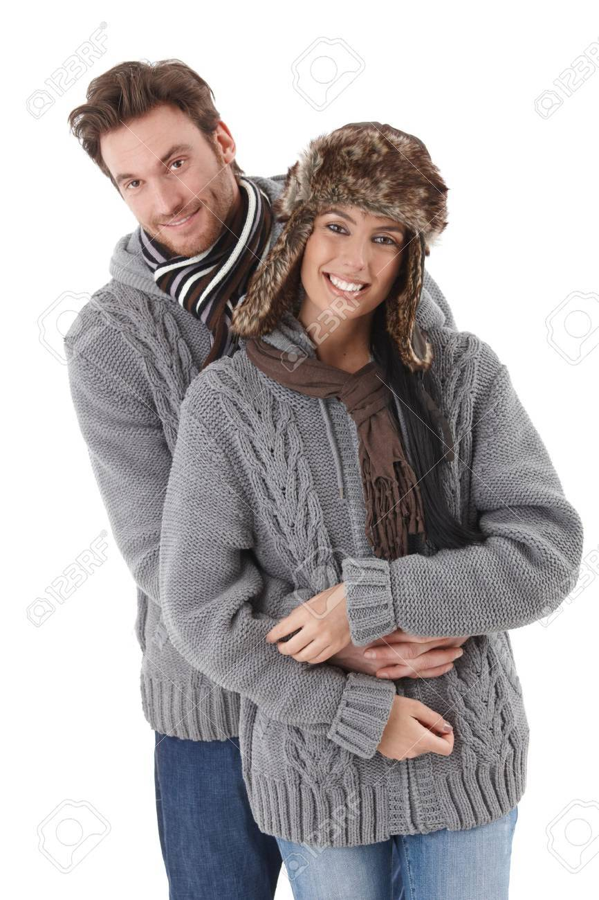 Young loving couple wearing the same sweater, smiling. Stock Photo - 9201951