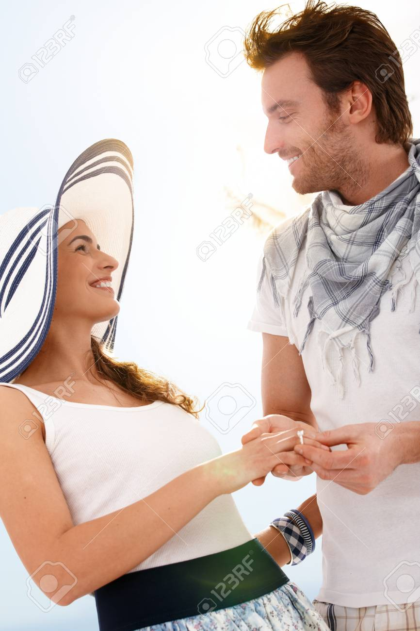 Happy young couple having fun together at summer, looking at each other, smiling. Stock Photo - 9201913
