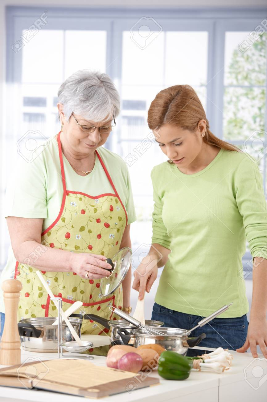 Senior mother and daughter cooking together in kitchen. Stock Photo - 9209262