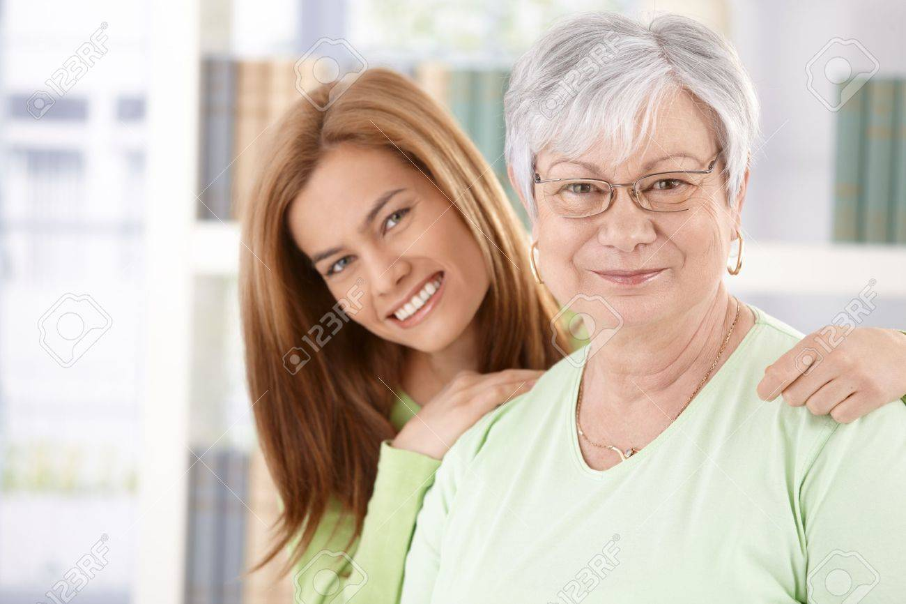 Portrait of elderly mother and daughter smiling happily. Stock Photo - 9208748