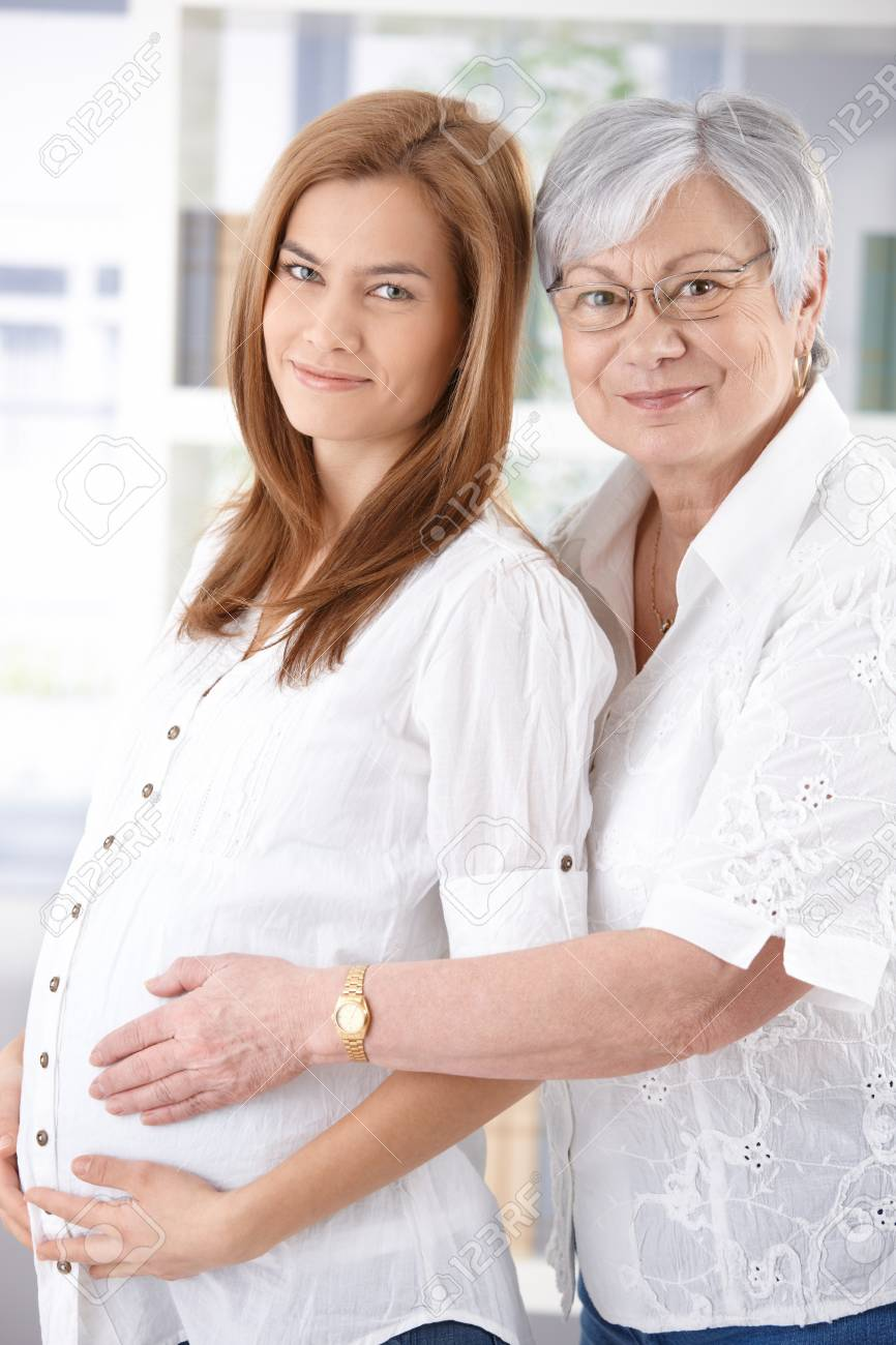Attractive pregnant woman and senior mother hugging, smiling. Stock Photo - 9209271