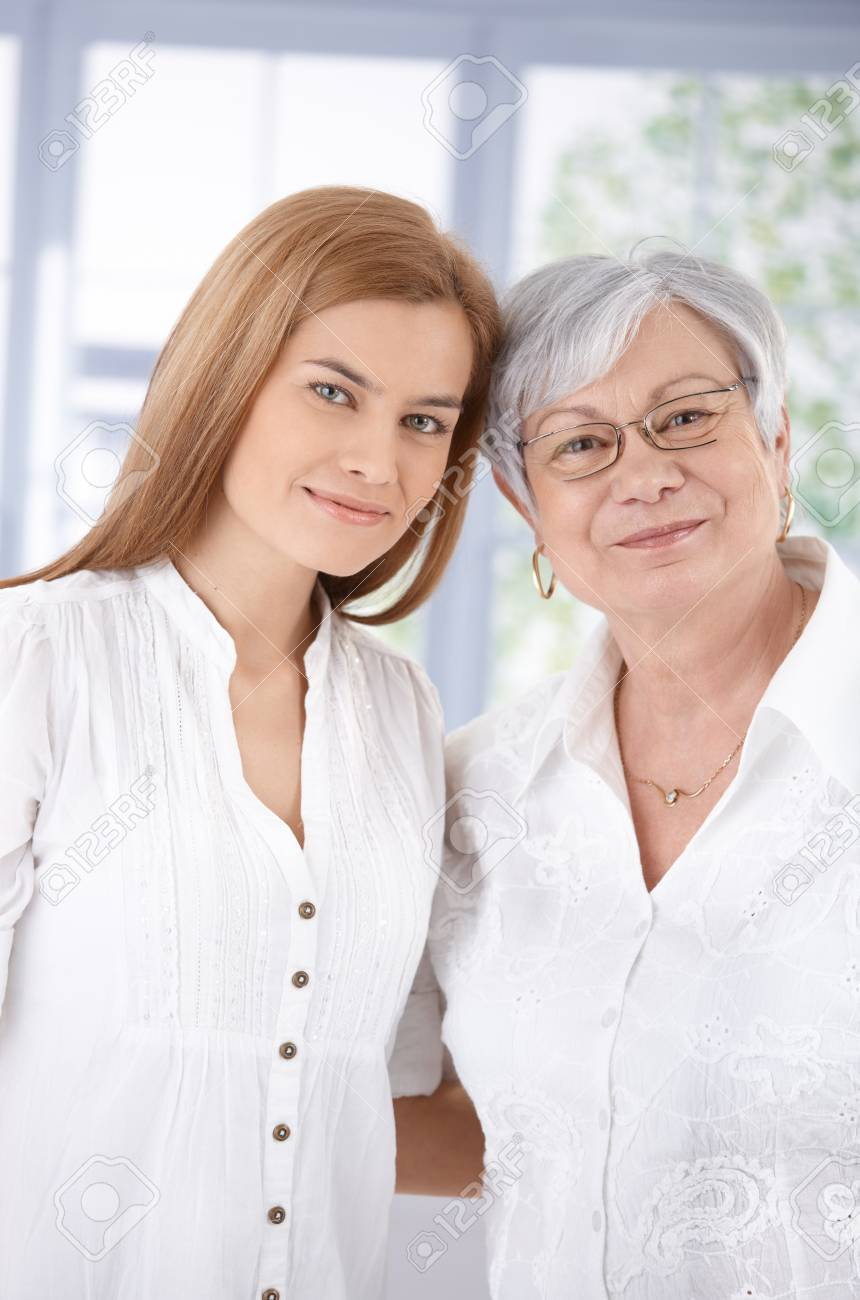 Portrait of senior mother and attractive adult daughter, hugging each other, smiling. Stock Photo - 9208735
