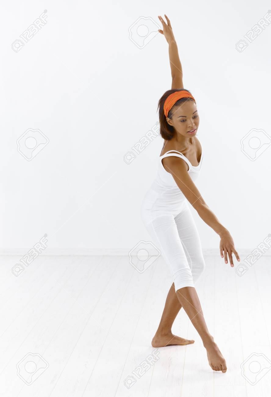 Afro ballerina dancing in studio, concentrating. Stock Photo - 9249482