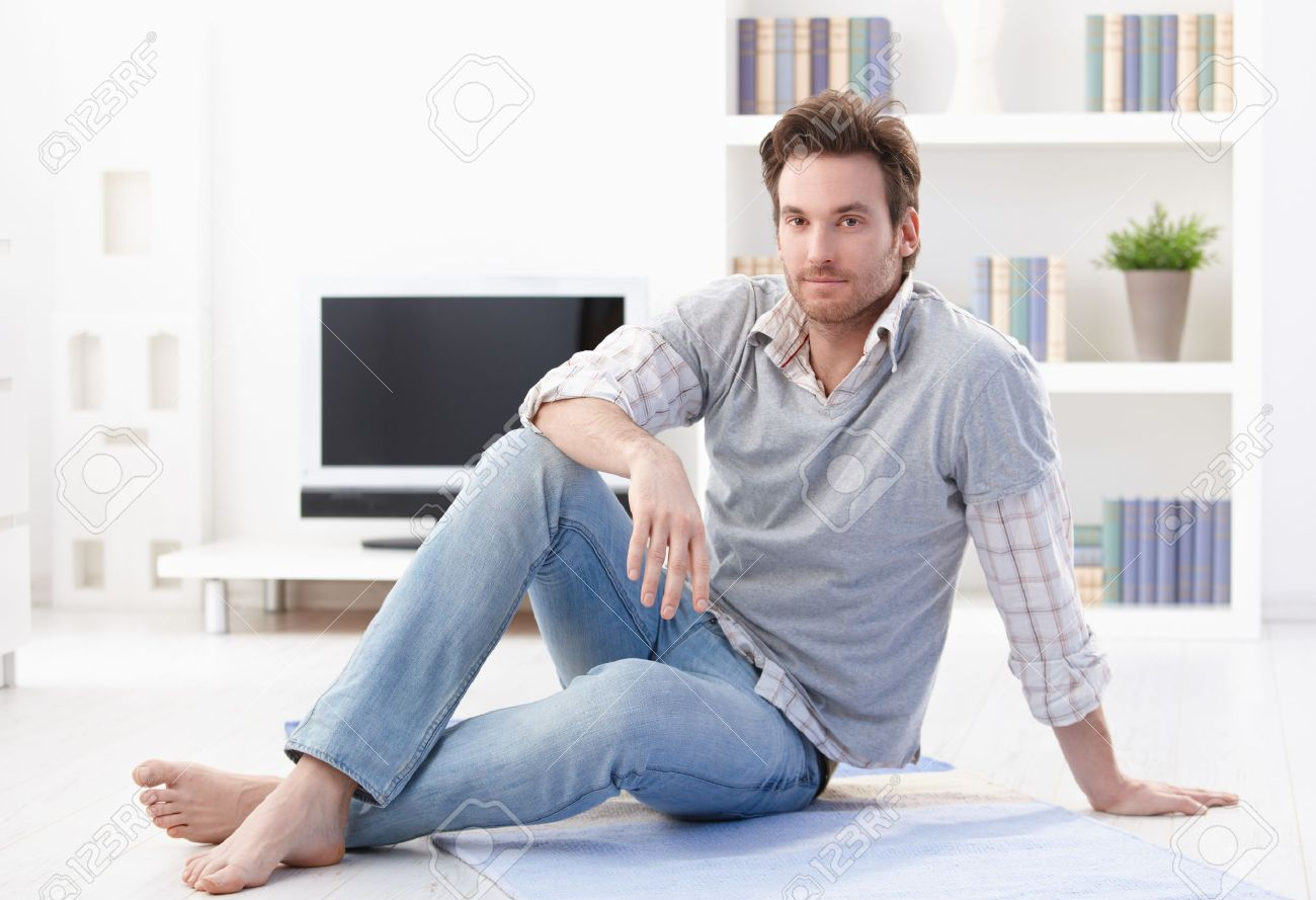 Man Living Room Handsome Young Man Sitting On Floor In Living Room Smiling Stock