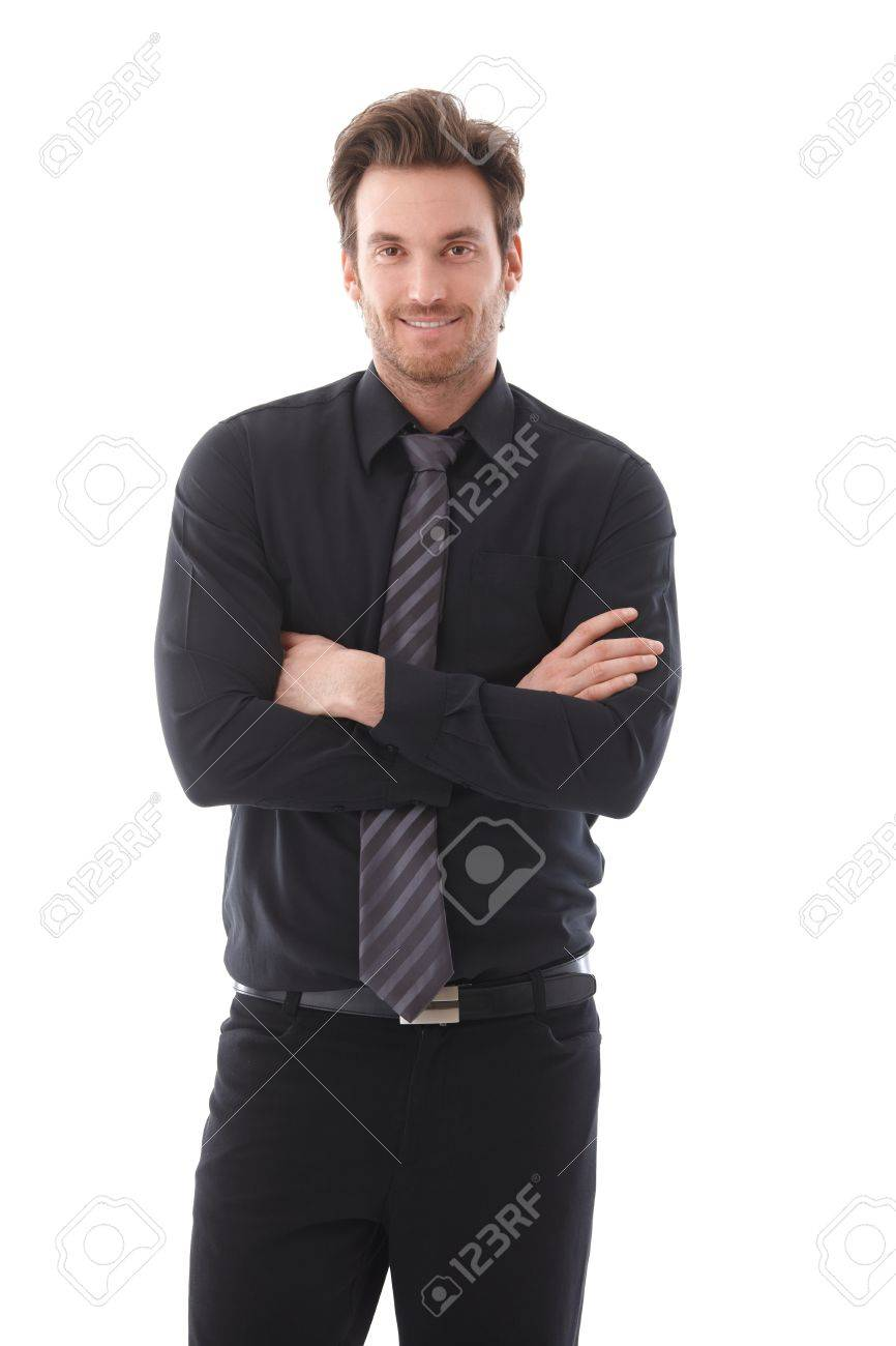 Confident young businessman standing arms crossed, smiling. Stock Photo - 9434664