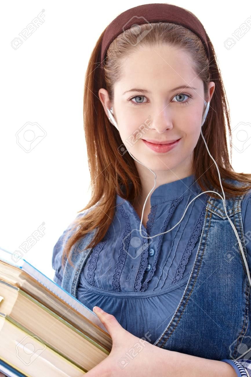 Portrait of college student listening music, holding books in hands, smiling. Stock Photo - 9564407