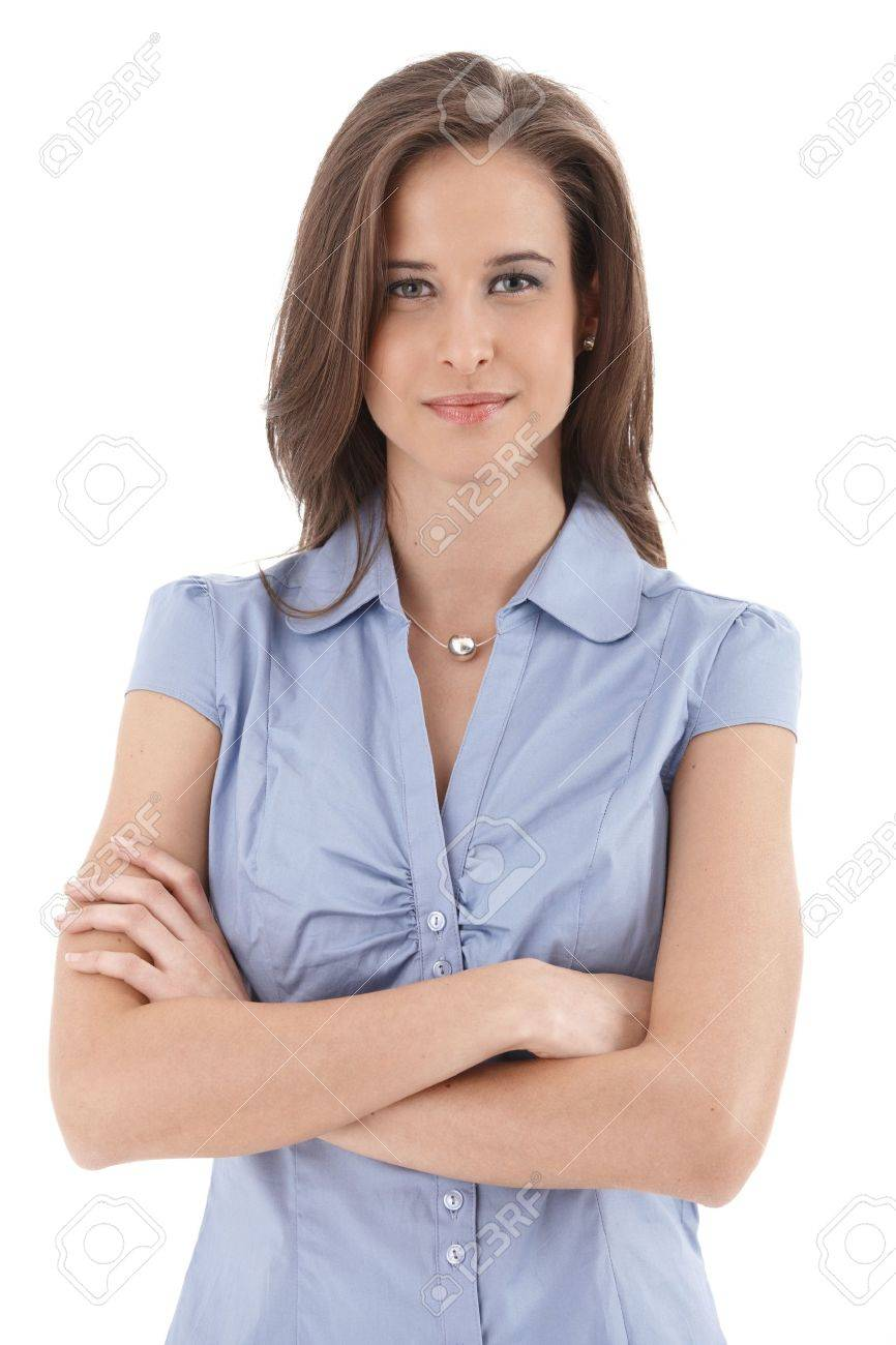 Young smiling businesswoman portrait, standing with arms folded, isolated on white. - 9563140
