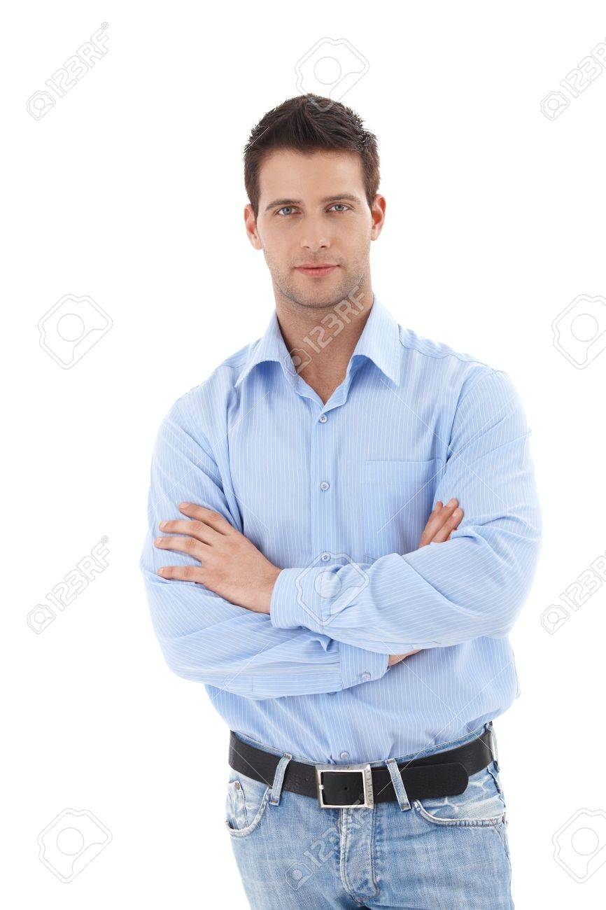 Studio portrait of handsome casual man standing with arms folded, looking at camera, isolated on white. - 9562506