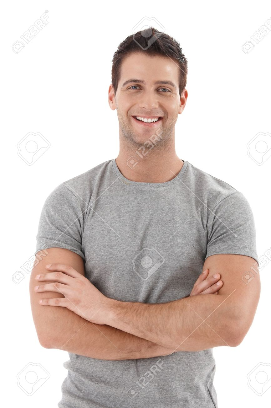 Casual portrait of happy university student guy standing with arms folded, laughing. - 9564399