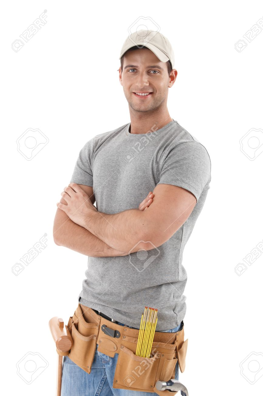 Handsome handyman in baseball hat standing with arms folded, smiling at camera, cutout on white. Stock Photo - 9563010