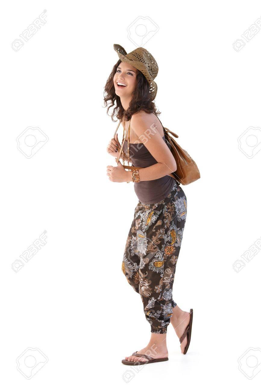 Happy female tourist walking, smiling. Stock Photo - 9712070