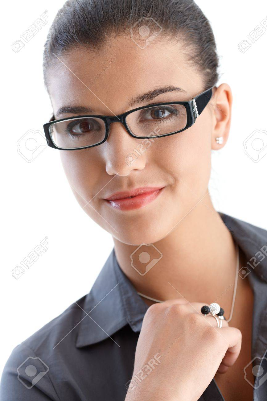 Portrait of confident young businesswoman wearing glasses, smiling. Stock Photo - 9712669