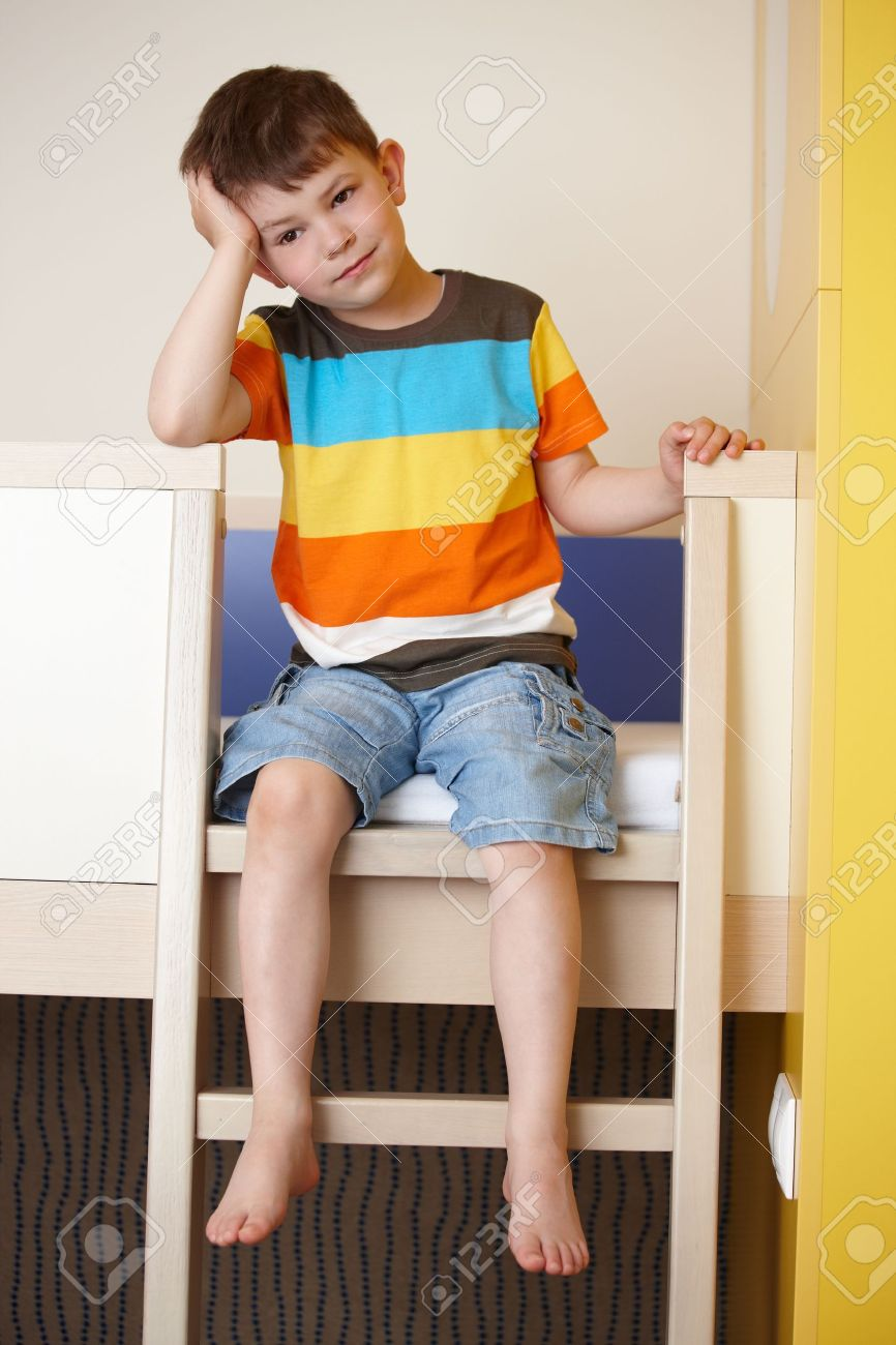 Picture of: Sleepy Little Boy Sitting On Bunk Bed Stock Photo Picture And Royalty Free Image Image 9868559