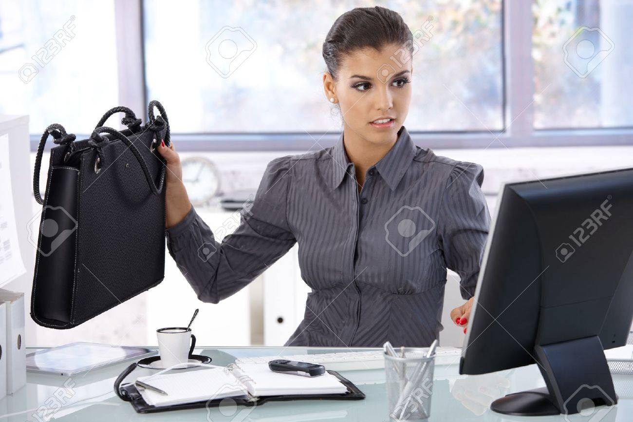 Busy businesswoman working at desk in bright office. Stock Photo - 10377678