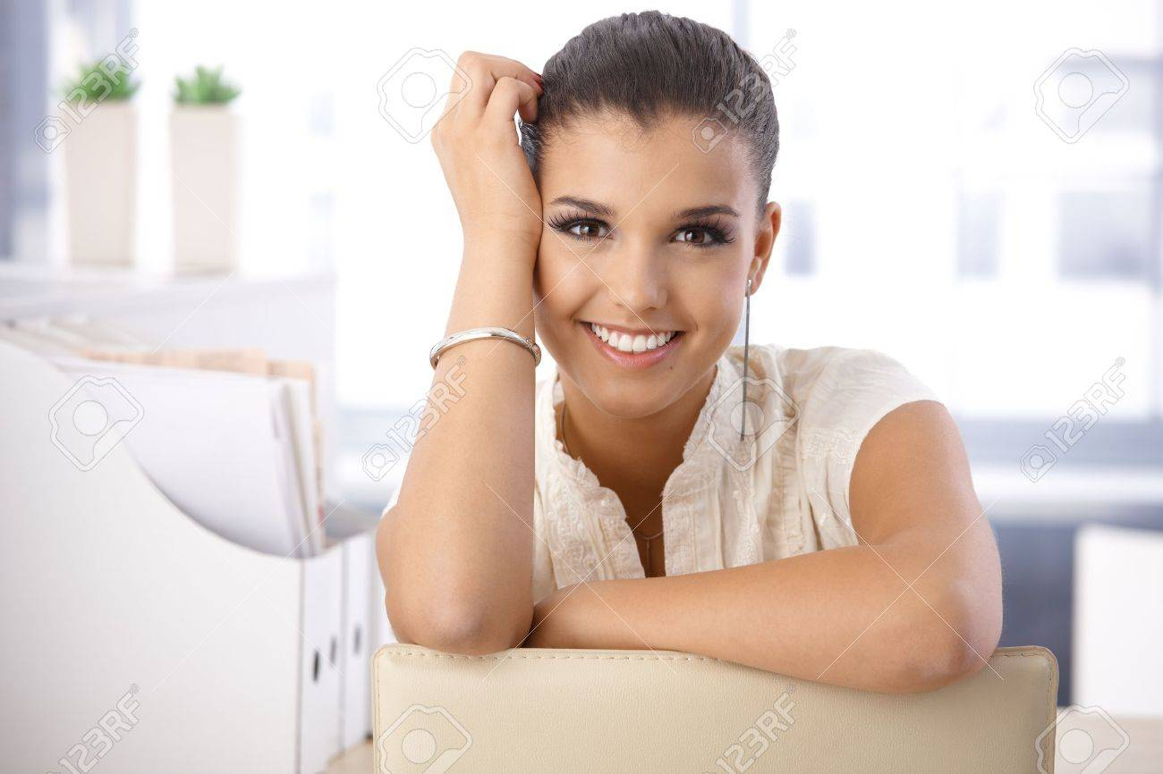 Portrait of beautiful young smiling girl in office. Stock Photo - 10377682