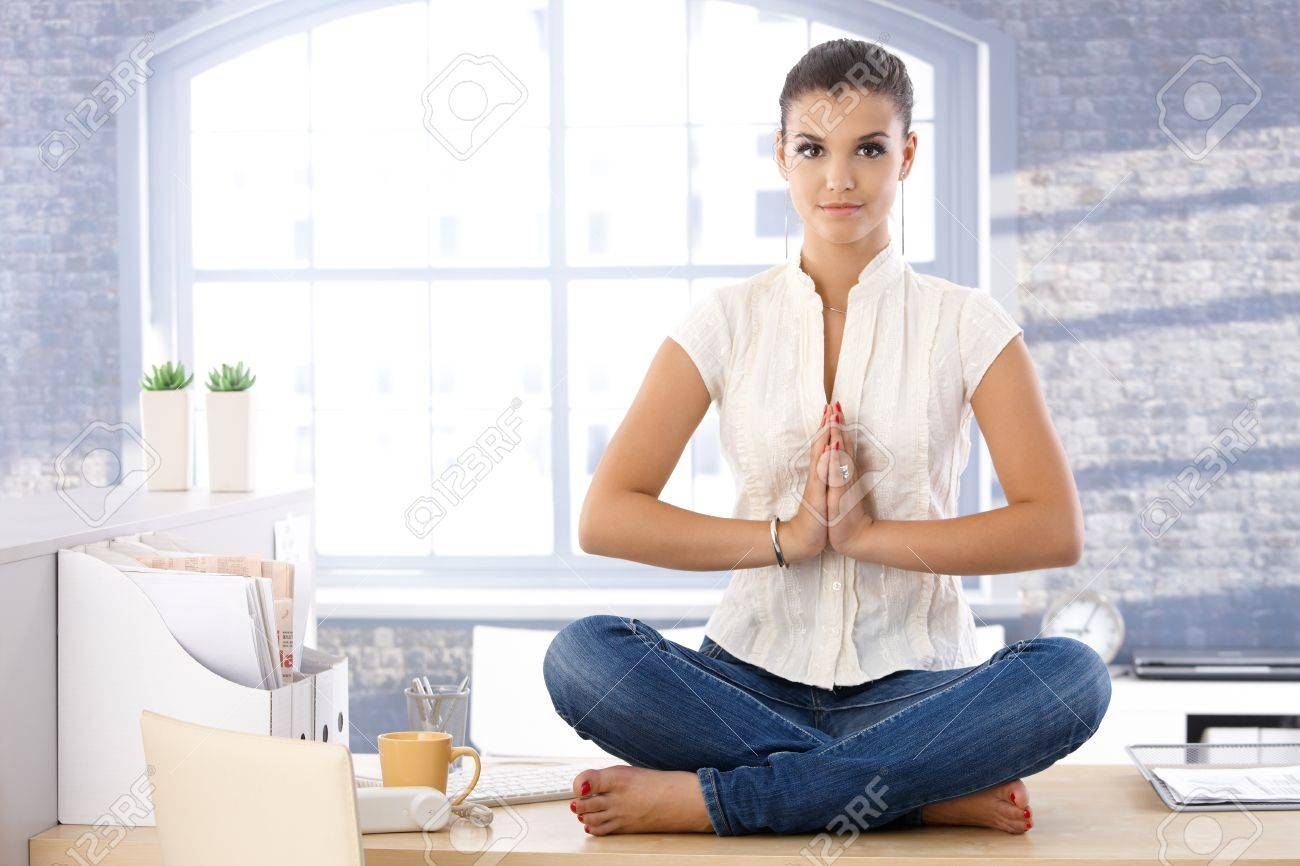 Attractive Young Woman Relaxing In Bright Office, Meditating. Stock Photo    10377590