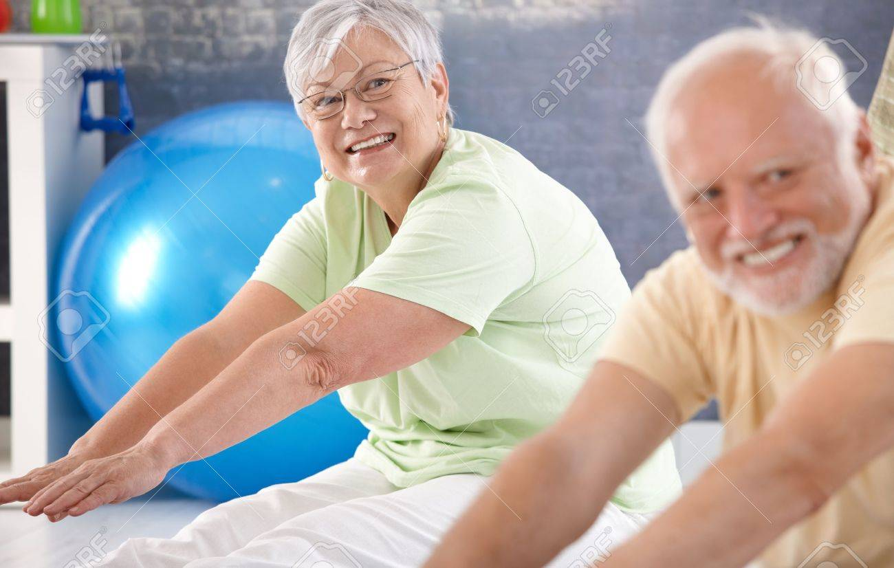 Vital old lady exercising in the gym. Stock Photo - 10389958