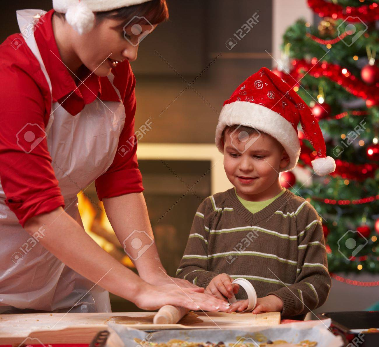 How to make christmas cake - Mother And Son Making Christmas Cake Son Watching Mum S Hand Smiling Stock Photo