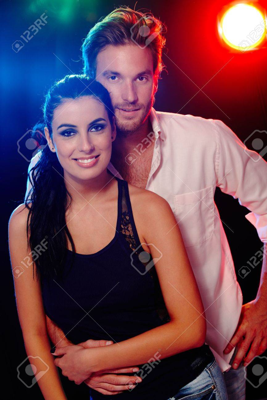 Attractive young couple smiling at a nightclub. Stock Photo - 11174308