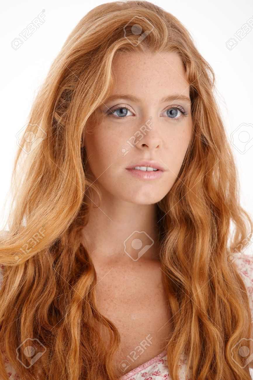 Closeup facial portrait of attractive redhead girl with long curly hair. - 11157825