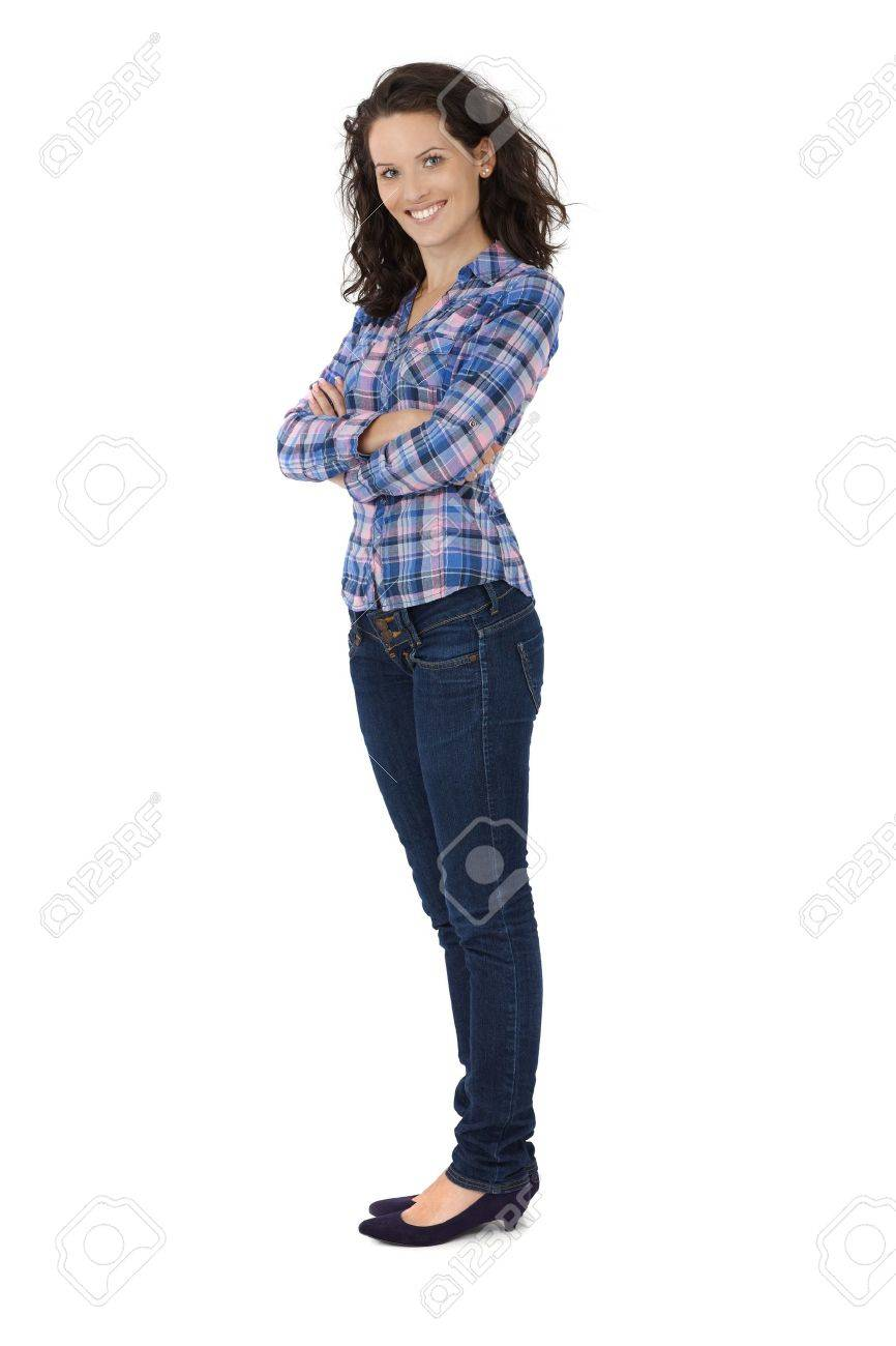 Attractive trendy young woman in jeans and shirt smiling with arms folded, cutout on white. Stock Photo - 12174523