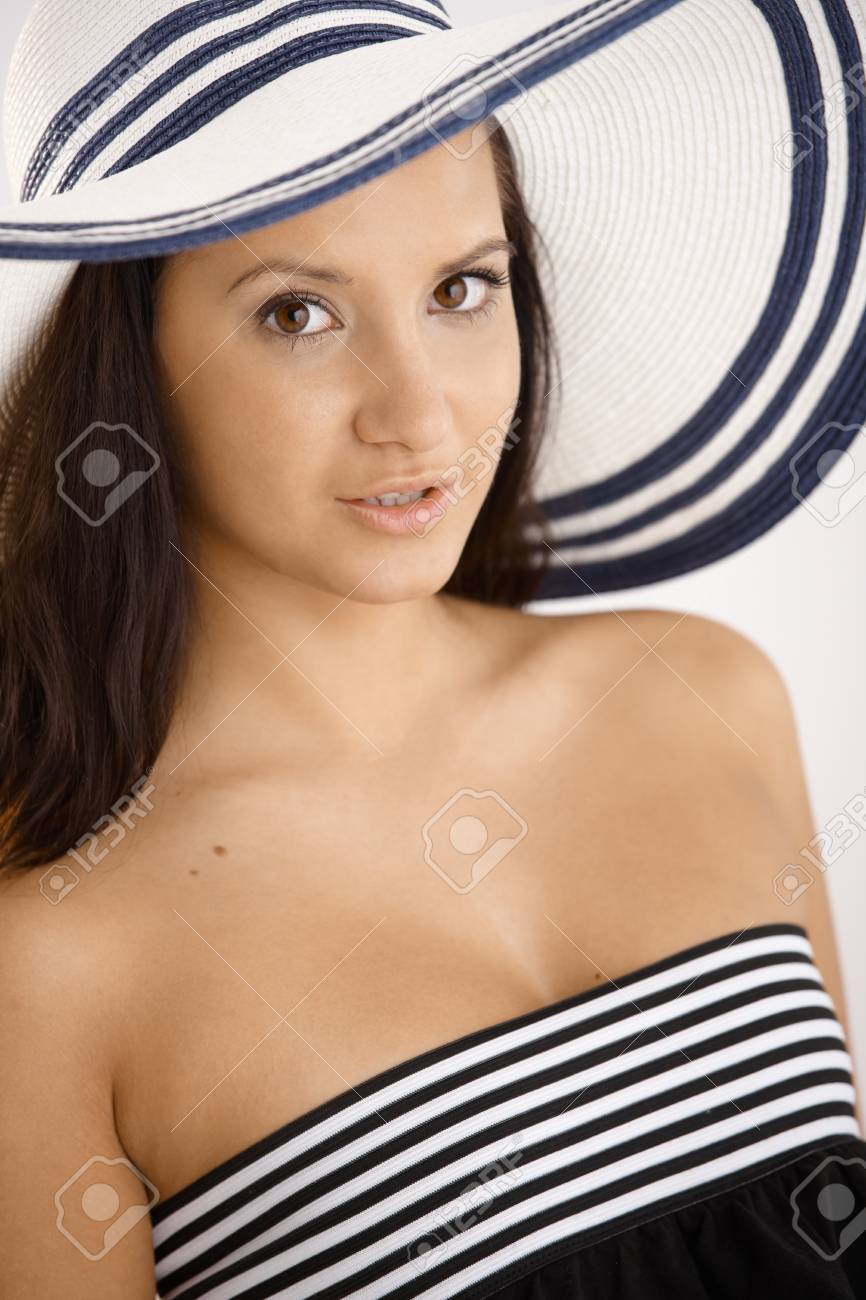 Summer portrait of young female in hat, looking at camera. Stock Photo - 12471784